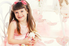 Adorable little girl with bouquet of tulips. Royalty Free Stock Image