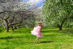 Adorable little girl with butterfly wings have fun Stock Photos