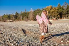 Adorable little girl with butterfly wings running Stock Image