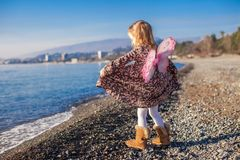 Adorable little girl with butterfly wings running Stock Images