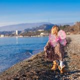 Adorable little girl with butterfly wings running Stock Photo