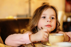 Adorable little girl at cafe Royalty Free Stock Photo