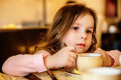 Adorable little girl at cafe Royalty Free Stock Images
