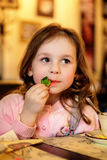 Adorable little girl at cafe Stock Photography