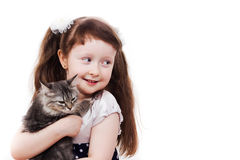 Adorable little girl with a cat. Smiling little girl holding a kitten in her hands Royalty Free Stock Photos