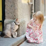 Adorable little girl and a cat outdoors Royalty Free Stock Photography