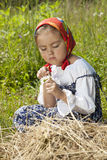 Adorable little girl with chamomile flowers Stock Photos