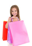 Adorable little girl child holding shopping colorful paper bags Stock Photo