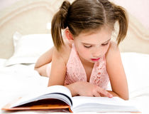 Free Adorable Little Girl Child Is Reading A Book Stock Image - 93952191
