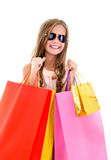 Adorable little girl child in sunglasses holding shopping colorf Stock Photos