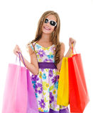 Adorable little girl child in sunglasses holding shopping colorf Stock Image