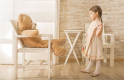Adorable little girl choosing the perfect dress for herself Stock Photo