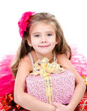 Adorable little girl with christmas gift boxes Royalty Free Stock Images