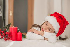 Adorable little girl  with Christmas hat Little girl sleeping, a Stock Photos