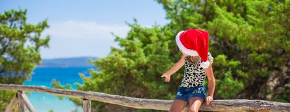 Adorable little girl in christmas hat during Stock Images