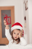 Adorable little girl with a Christmas lantern in hand, waiting f stock image