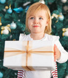Adorable little girl with Christmas present Royalty Free Stock Photography