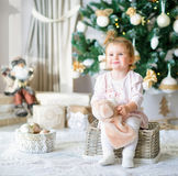 Adorable little girl by the Christmas tree Royalty Free Stock Images