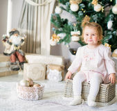 Adorable little girl by the Christmas tree Royalty Free Stock Photos
