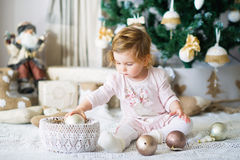 Adorable little girl by the Christmas tree Stock Photography