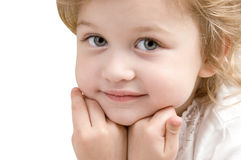 Adorable little girl close-up on white background. Adorable little girl looking ahead close-up on white background Stock Image