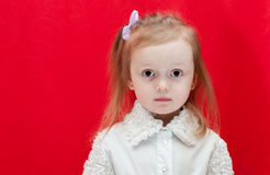 Adorable little girl - closeup portrait. Littlebit emootions from girl on red background Royalty Free Stock Photos