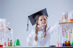 Adorable little girl conducting experiment in lab Stock Photography