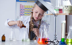 Adorable little girl conducting an experiment Stock Images