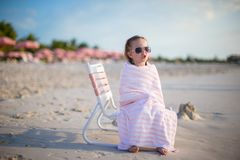 Adorable little girl covered with towel sitting on Stock Image