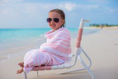 Adorable little girl covered with towel sitting on Stock Photo