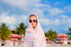 Adorable little girl covered with towel at Royalty Free Stock Photography