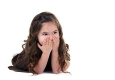 Adorable Little Girl Covering Her Mouth Laughing Stock Photos