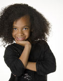 Adorable little girl with curly hair Stock Photography