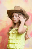 Adorable little girl with cute face in western cowboy hat Royalty Free Stock Image