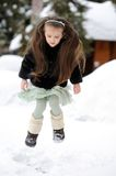 Adorable little girl dances in the snow Royalty Free Stock Image