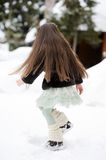 Adorable little girl dances in the snow Royalty Free Stock Photography