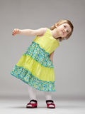 Adorable little girl dancing Stock Image