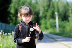 Adorable little girl  with  dandelions Royalty Free Stock Image