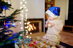 Adorable little girl decorating a Christmas tree Stock Photography