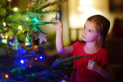 Adorable little girl decorating a Christmas tree Royalty Free Stock Photography