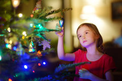 Adorable little girl decorating a Christmas tree Stock Images