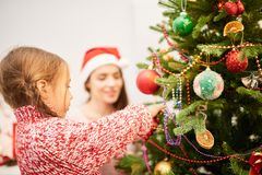 Adorable Little Girl Decorating Christmas Tree Royalty Free Stock Photography