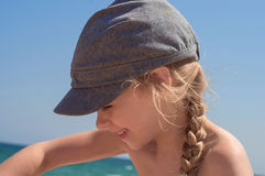 Adorable little girl in denim cap Royalty Free Stock Images
