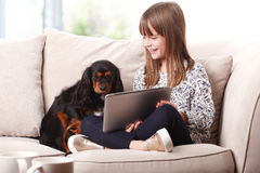 Adorable little girl with digital tablet Stock Image