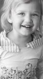 Adorable little girl with dirty face closeup Stock Photos