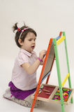 Adorable little girl draw on black board with chalk. Isolated Stock Photo