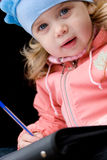 Adorable little girl drawing Stock Photo