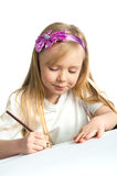 Adorable little girl drawing artwork Stock Photo