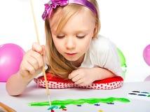 Adorable little girl drawing artwork Stock Photos