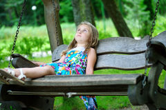 Adorable little girl drawing outside with chalk stock photography